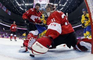 APTOPIX-Sochi-Olympics-Ice-Hockey-Men-1