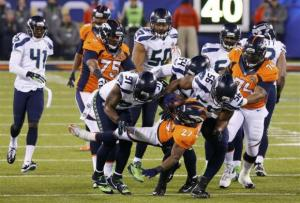 Broncos Moreno is tackled by Seahawks Clemons during the NFL Super Bowl XLVIII football game in East Rutherford